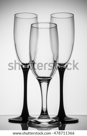 Silhouette champagne glasses black and white on grey background