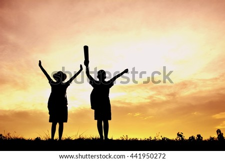 Silhouette children at sunset. Concept travel