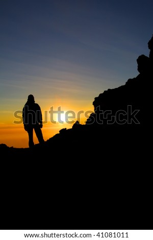 Silhouette climber. Summit of Merapi volcano Java - Indonesia