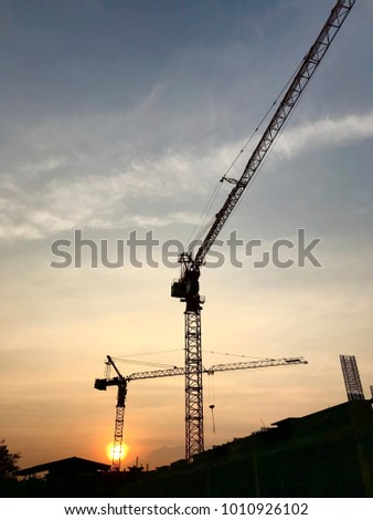 Silhouette construction site background