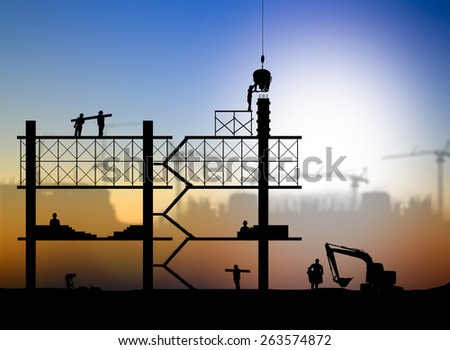 silhouette construction worker on construction site - stock photo