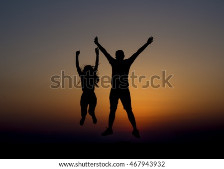 Silhouette Couple Jumping