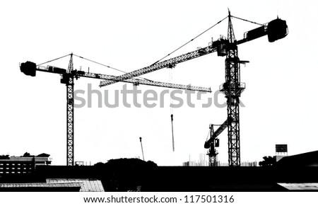 silhouette crane building - stock photo