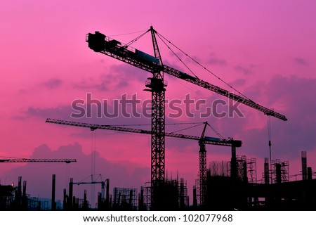 silhouette crane building and sunset of Southeast Asia