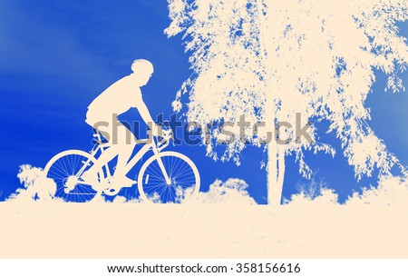 silhouette cycling vintage bicycle on blue background