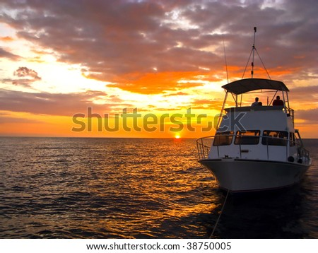 Silhouette Dive Boat in Hawaii off of Kona - stock photo
