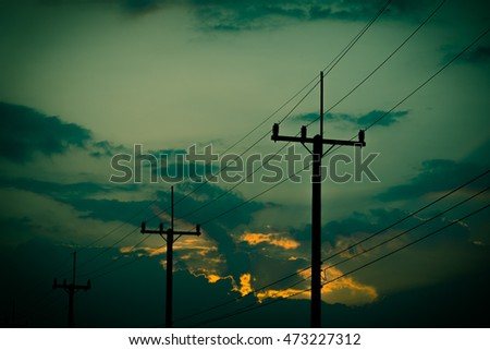 Silhouette electricity post with beautiful sunset background. Vintage tone