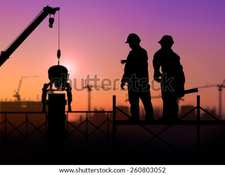 silhouette engineer looking a building site over Blurred construction worker on construction site - stock photo