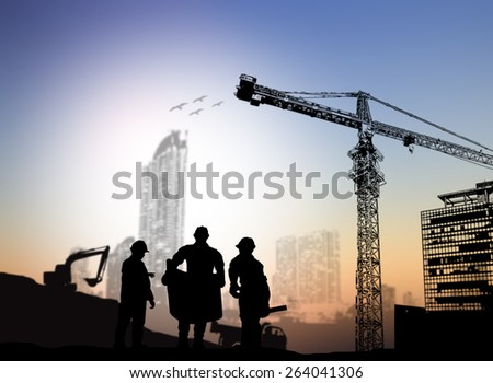 silhouette engineer looking at blueprints Blurred construction site - stock photo