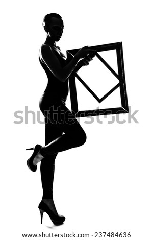 Silhouette fashion slim girl dancing in high heels with frame - stock photo