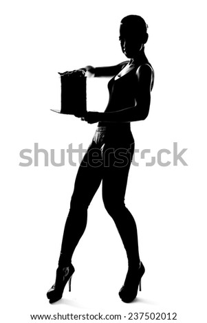 Silhouette fashion slim girl dancing with hat cylinder - stock photo