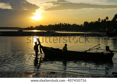 silhouette fisherman with sunrise sky