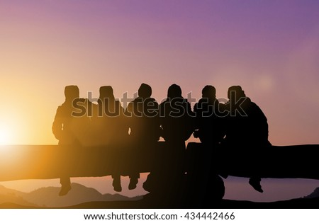 Silhouette friends imaging touch cold on the mountain peaks in winter. Dear friend, do not leave each other. Concept friends Party. The coalition parties in the holiday New Year. Day thanks to God - stock photo