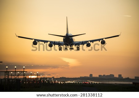 Silhouette from an airplane, photo taken during sunrise. - stock photo