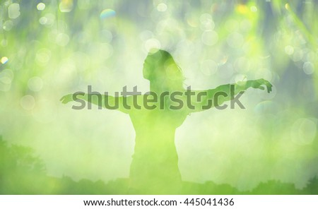 Silhouette happy woman. Double exposure, flying woman on a green nature background with green natural bokeh. Ecology concept. - stock photo