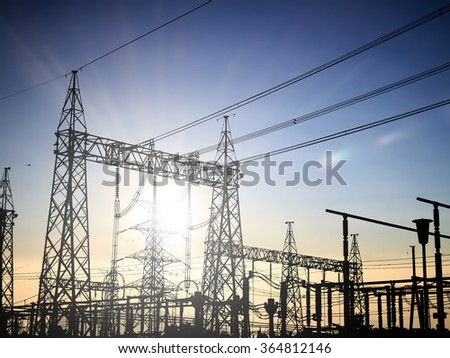 silhouette high voltage post.High-voltage tower over blur sky background.Industrial Land Scape - stock photo