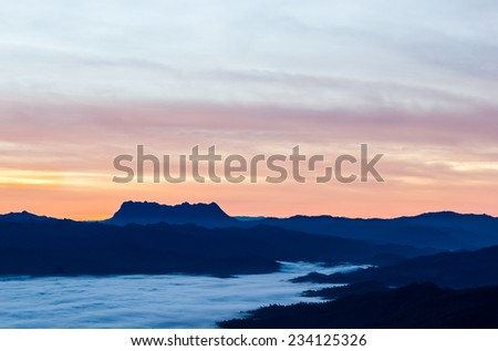 Silhouette hills and misty in the morning at Wiangheang,Chiangmai,Thailand. - stock photo