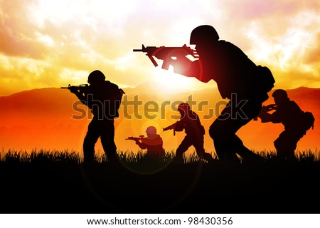 Silhouette illustration of a group of soldiers in assault formation - stock photo