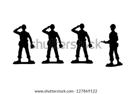 Silhouette image of a group of military toy soldiers standing on a white background - stock photo