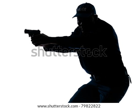 Silhouette image of an afro American mature police officer aiming a handgun in studio on white isolated background - stock photo