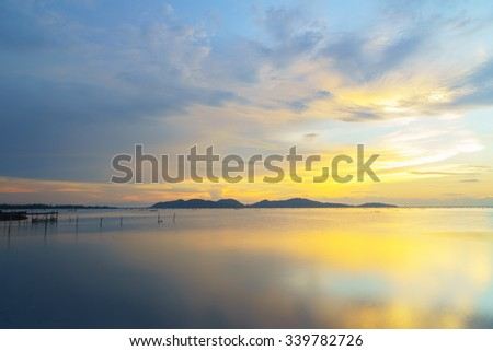 Silhouette image of Sunset view at Songkhla Lake Thailand:select focus with shallow depth of field:ideal use for background. - stock photo
