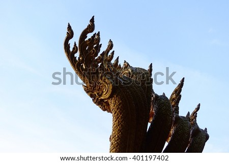 Silhouette image ofl Stucco King of Nagas (animal in mythology of Southeast Asian ) sculpture decorated in Thai temple:Select focus with shallow depth of field.