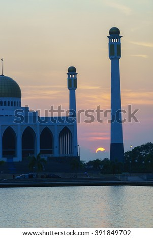 Silhouette Image view of Center Mosque Songkhla in evening:select focus with shallow depth of field.ideal use for background.