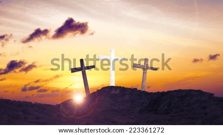 Silhouette impression of the three crosses on the mountain golgotha representing the day of christs crucifixion in a sunset. Christmas background, Worship, Forgiveness, Humble, Thanksgiving concept. - stock photo