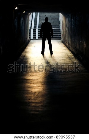 silhouette in a subway tunnel - stock photo