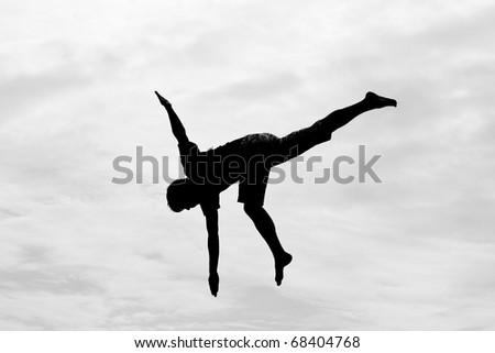 Silhouette jumping on trampoline outdoor - stock photo