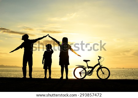 Silhouette life and activity on the beach at dusk. - stock photo
