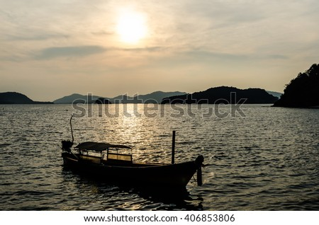Silhouette long tail boat with cloudy sky when sunset. Thailand