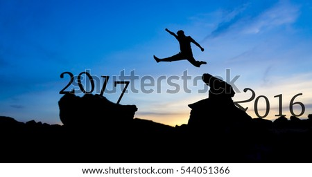 Silhouette man jumping between 2016 and 2017