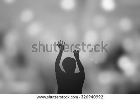 silhouette man praying over blurred twilight sky backgrounds.man pray to god for receiving power,strong and protect and blessing.religious concept. - stock photo