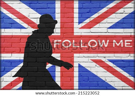 silhouette man with bowler in brick wall background with great britain painted flag and follow me text