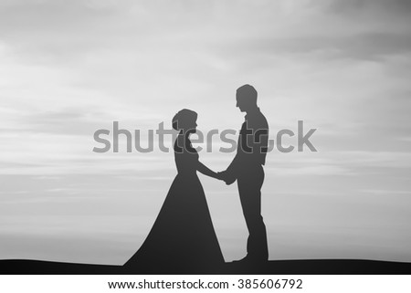 silhouette married lovers couple over natural background at the beach:black shadow loving people holding/touching hand:love and valentines concept:matrimonial/amour/affection/wedding/anniversary - stock photo