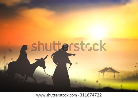 Silhouette Mary and Joseph journeying through the dessert with a donkey on sunset looking for a place to stay on Christmas Eve. Nativity scene story, Christmas background concept. - stock photo