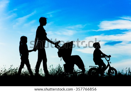 silhouette mother with children walking.