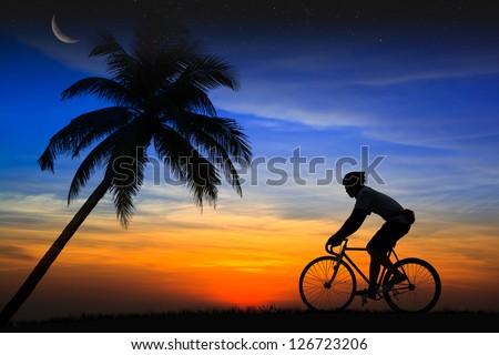 Silhouette Mountain bike rider - stock photo