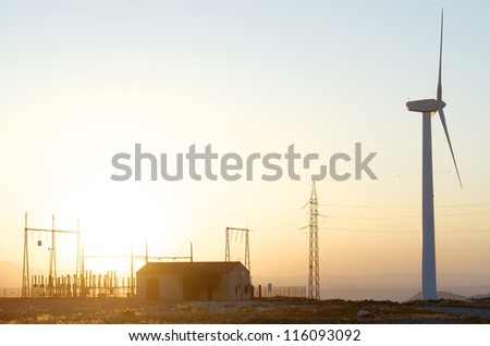 silhouette of a alectrical substation and windmill, La Muela, Zaragoza, Aragon, Spain - stock photo