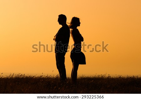 Silhouette of a angry woman and man on each other.Relationship difficulties - stock photo