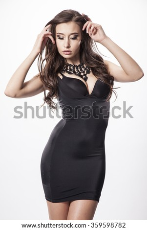 silhouette of a beautiful young adult slim sexy and attractive sensuality pretty brunette long hairs woman in black elegance fashionable dress isolated on white background