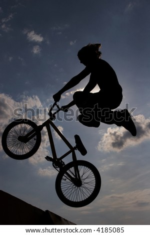 silhouette of a bmx rider - stock photo