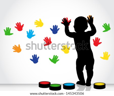 silhouette of a child draws on a white wall with colored hand prints - stock photo