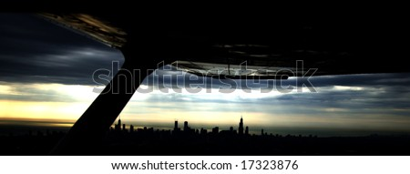 Silhouette of a city's sunset  from the view of an airplane