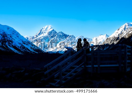 Silhouette of a couple at Kea Point, New Zealand overlooking Mount Cook (low peak of 3,500 meter)