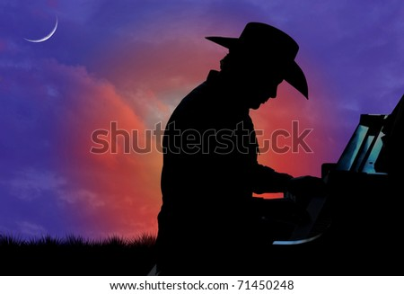 Silhouette of a cowboy playing the piano with a sunset in the background - stock photo