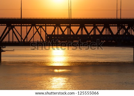 silhouette of a departing train at sunset - stock photo