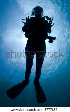 Silhouette of a diver in the Caribbean Sea - stock photo