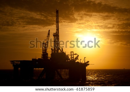 Silhouette of a drilling rig.  Coast of Brazil - stock photo